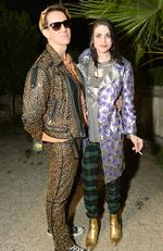 Frances Bean Cobain poses with fashion designer Jeremy Scott at an official Coachella party. Picture: Splash News