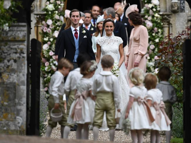 Pippa Middleton poses for a photograph with her new husband James Matthews following their wedding ceremony at St Mark's Church in Englefield, west of London. Picture: Justin Tallis