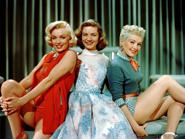"""Actor Marilyn Monroe with Lauren Bacall and Betty Grable in scene from film """"How To Marry A Millionaire"""". Picture: Supplied"""