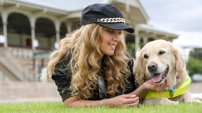 Rachael Leahcar with her guide dog Ella. Picture: AAP/Russell Millard