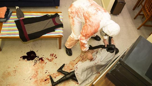 Shawn Harkins preparing one of the crime scenes for his students. Photo: Richard Tuffin