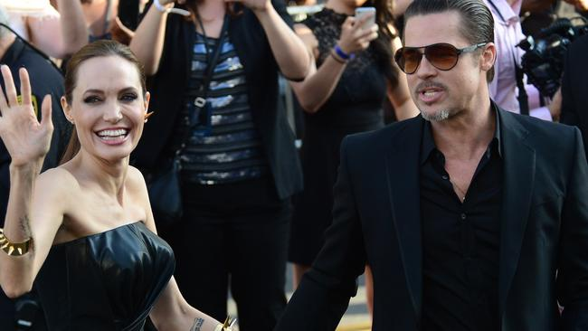 Angelina Jolie greets the crowds at she arrives at Malificent premiere in May 2014.