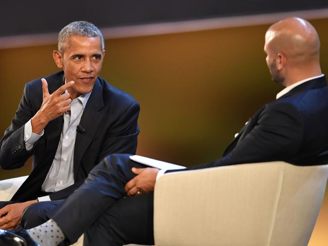 Barack Obama (left) speaks with Sam Kass, food entrepreneur and former White House chef, at the 'Seed & Chips: The Global Food Innovation Summit' in Milan. Picture: AFP/Andreas Solaro