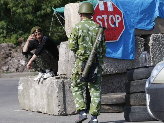 On guard ... Pro-Russian fighters talk at a check-point near the city of Kramatorsk, Donetsk region, eastern Ukraine.