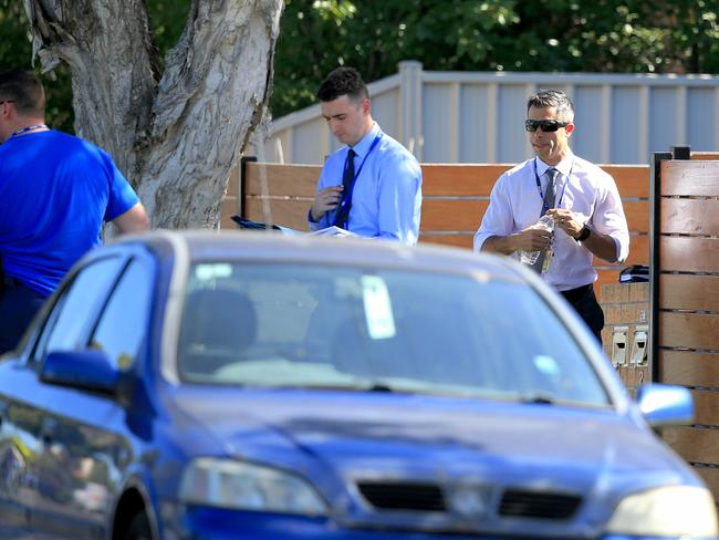 Detectives at the scene on Monday afternoon after a child was found in a car. Picture: Mark Stewart
