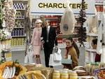 PARIS FASHION WEEK 2014: Models walk in a supermarket set up for the Chanel fashion show. Picture: AP