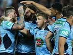 NSW centreJosh Dugan celebrates scoring a try in the second half of State of Origin III.