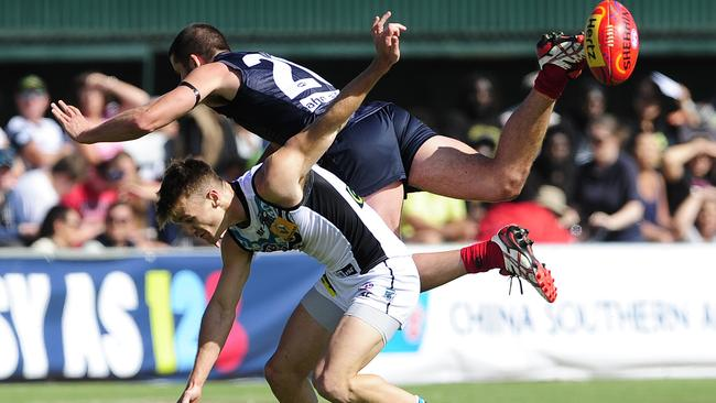 Melbourne's Colin Garland flies high over Port Adelaide's Robbie Gray at Traeger Park. Picture: Justin Brierty
