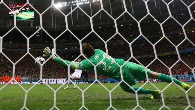 Tim Krul of the Netherlands saves a penalty kick by Michael Umana.