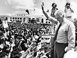 NOVEMBER 12, 1975 : Ousted PM Gough Whitlam outside federal parliament in Canberra 12/11/75 waving to supporters day after government dismissed by GG Kerr. Pic Ross Duncan.