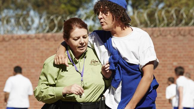 Jonah (Chris Lilley) chats with Therese.