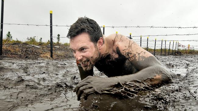 David King of Annerley in the 'Kiss of Mud'. Picture: Brad Cooper
