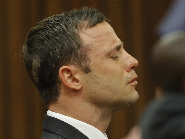 Oscar Pistorius reacts in the Pretoria High Court on September 11, 2014, in Pretoria, South Africa. Picture: Getty