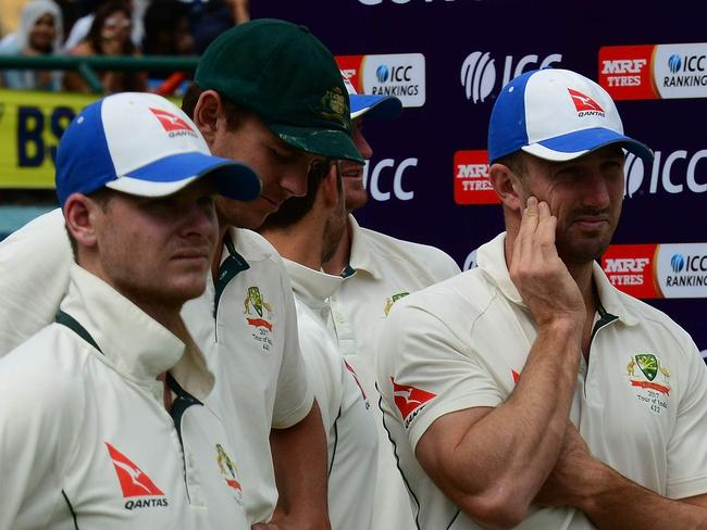 Australia's captain Steve Smith (L) waits with teammates during the award ceremony on the fourth day of the fourth and final cricket Test match between India and Australia at The Himachal Pradesh Cricket Association Stadium in Dharamsala on March 28, 2017. ----IMAGE RESTRICTED TO EDITORIAL USE - STRICTLY NO COMMERCIAL USE----- / GETTYOUT---- / AFP PHOTO / PRAKASH SINGH / ----IMAGE RESTRICTED TO EDITORIAL USE - STRICTLY NO COMMERCIAL USE----- / GETTYOUT