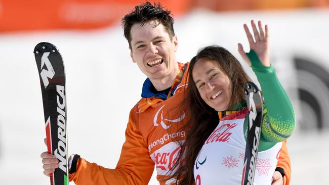Melissa Perrine with her guide Christian Gieger after winning bronze.