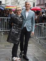 Australian film director Baz Luhrmann and his wife Catherine Martin, arrive to attend the Jean-Paul Gaultier Fall Winter 2014-15 Haute Couture fashion collection, presented in Paris. Picture: AP