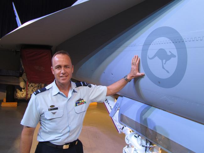 Taking delivery ... Commander of the RAAF's Air Combat Group Air Commodore Steve Roberton with the first Australian 'Growler' jet at the rollout ceremony in St Louis.