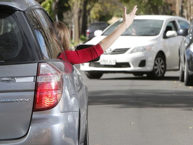 A motorist shows her frustration on Te Anau Ave in Prospect. Picture: Calum Robertson