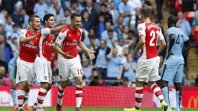 Arsenal's Aaron Ramsey, third left, celebrates his goal against Manchester City with teammates.