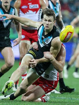 Robbie Gray gets his kick away under pressure against Sydney. Picture: Sarah Reed