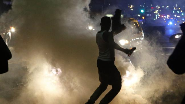 Tear gas ... Ferguson protesters flee from police. Picture: AP Photo/St. Louis Post-Dispatch, J.B. Forbes