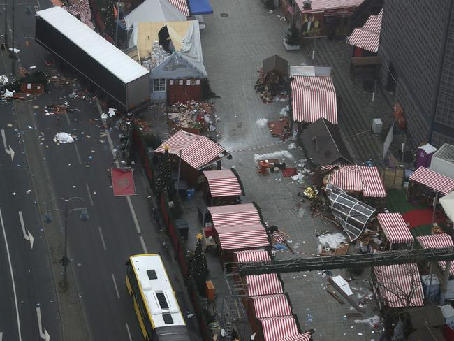 The morning after: the trailer of a truck stands beside Christmas market huts in Berlin, Germany. Picture: AP