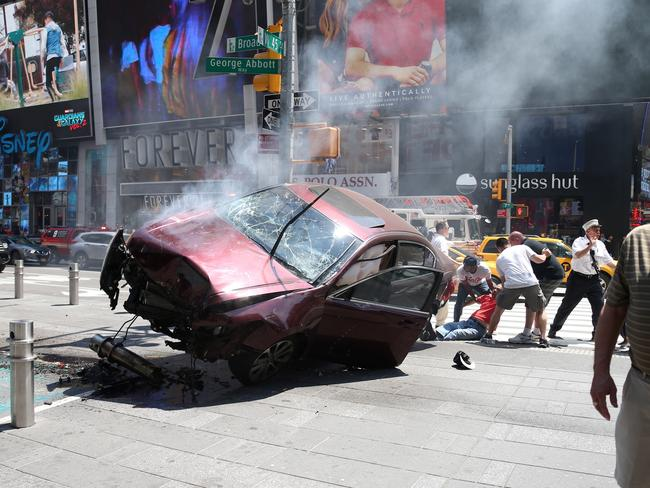 The car ploughed into pedestrians shortly after midday New York time. Picture: Diimex.