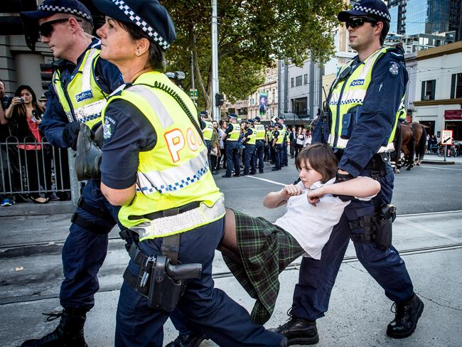 Police carry away a teenage protester. Picture Jason Edwards