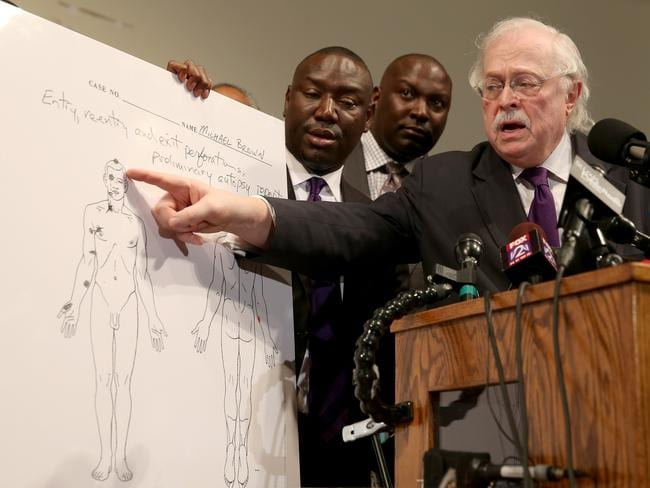 Shot six times ... Dr Michael Baden points to an autopsy diagram showing where the gun shots hit Michael Brown.