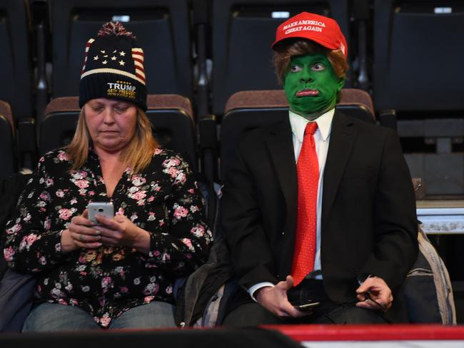 Trump supporters at the US Bank Arena in Cincinnati, empty seats behind them. Picture: Timothy A. Clary/AFP