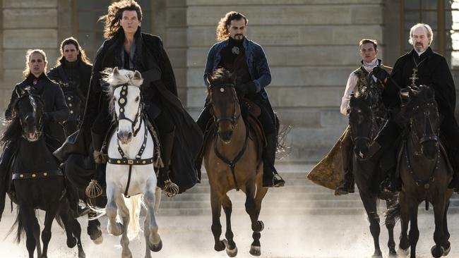 """On horseback ... Brosnan says his Louis XIV has """"a magnificent wig, a great-looking horse and lots of attitude""""."""