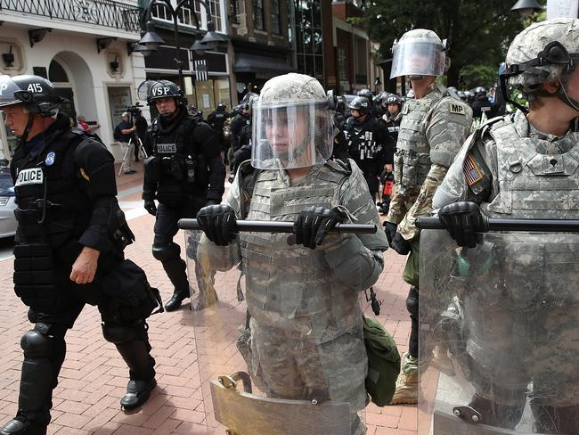 Police and members of the National Guard patrol near the scene. Picture: AFP