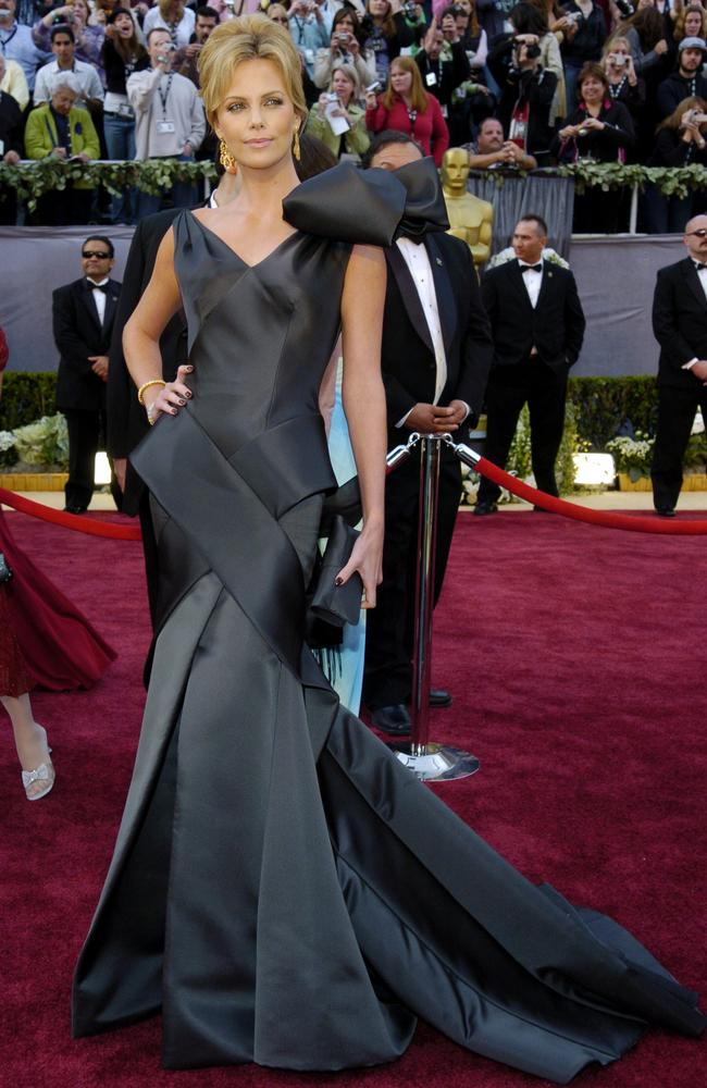 Looking like she stepped right off the set of Dynasty, Charlize Theron was nominated for an Oscar for best actress in a leading role for her work in 'North Country', but won the award for most over-the-top gown at the 2005 Oscars. Picture: Getty