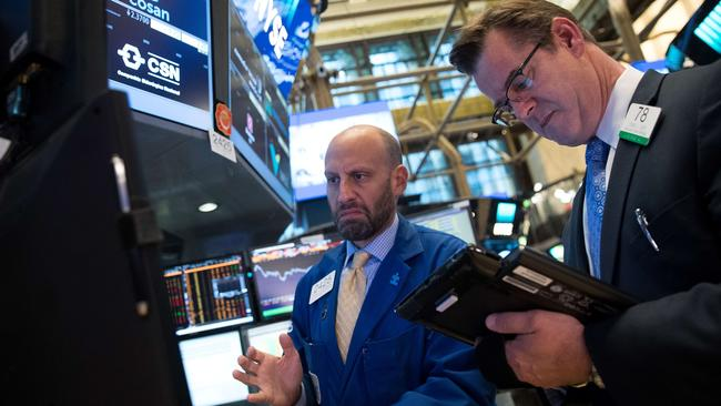 Traders and financial professionals work on the floor of the New York Stock Exchange (NYSE) following the opening bell, May 18, 2017 in New York City. Picture: Drew Angerer/Getty Images/AFP