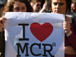MANCHESTER, ENGLAND - MAY 23: Members of the public gather at a candlelit vigil, to honour the victims of Monday evening's terror attack, at Albert Square on May 23, 2017 in Manchester, England. Monday's explosion occurred at Manchester Arena as concert goers were leaving the venue after Ariana Grande had just finished performing. Greater Manchester Police are treating the explosion as a terrorist attack and have confirmed 22 fatalities and 59 injured. (Photo by Jeff J Mitchell/Getty Images)