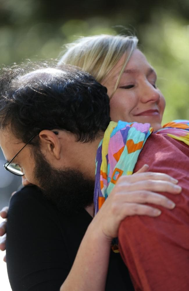 Larissa Waters is consoled by Greens Brisbane city councillor Jonathan Sri. Picture: Annette Dew