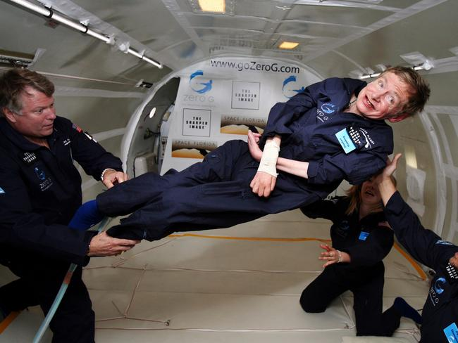 "Hawking floats on a zero-gravity jet in 2007. The modified jet carrying Hawking, a handful of his physicians and nurses, went through a series of manouvres to induce weighlessness - during which Hawking made two weightless flips like ""a gold-medal gymnast,"" said Peter Diamandis, chairman of Zero Gravity Corp. Picture: AP"