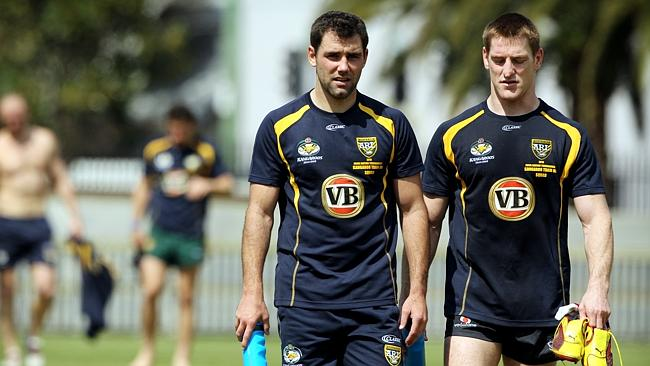 Cameron Smith and Brent Tate train with the Kangaroos.