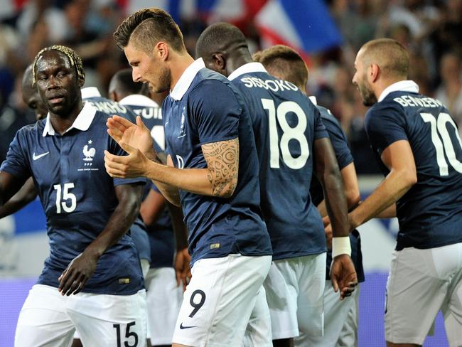 France celebrates a goal in one of its World Cup warm up games.