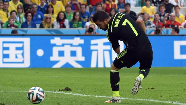 TOPSHOTS Spain's forward David Villa flicks the ball home.