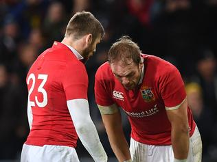 British and Irish Lions' Elliot Daly (L) and Alun Wyn Jones react after defeat during the rugby union match between the Otago Highlanders and the British and Irish Lions at Forsyth Barr Stadium in Dunedin on June 13, 2017. / AFP PHOTO / Marty MELVILLE