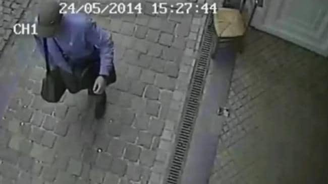 Caught on camera ... photos and video show the suspect wearing a cap and blue shirt and carrying two bags. Picture: Federal Police of Belgium