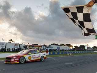 A supplied image of Fabian Coulthard of DJR Team Penske winning the race 1 of the WD-40 Phillip Island 500, at the Phillip Island Grand Prix Circuit, Phillip Island, Victoria, Saturday, April 22, 2017. (AAP Image/Mark Horsburgh) NO ARCHIVING, EDITORIAL USE ONLY