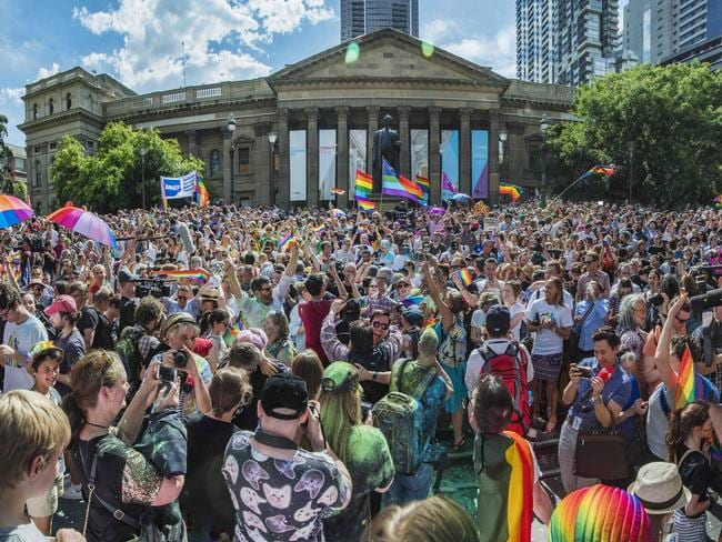 Thousands celebrate at the SSM Same Sex Marriage result party on the steps of the State Library of Victoria. Picture: Jason Edwards