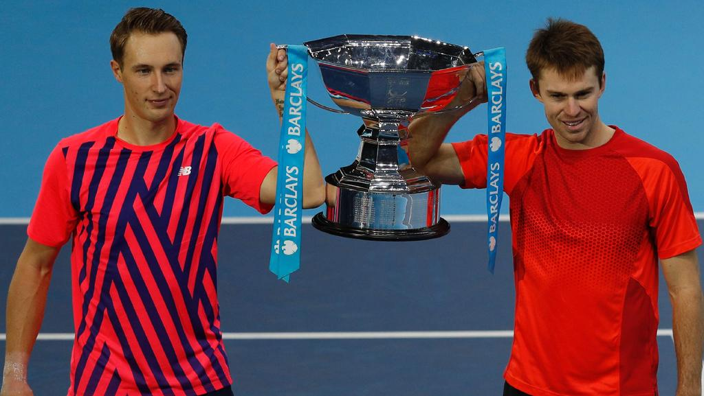 Finland's Henri Kontinen (L) and Australia's John Peers (R) celebrate after winning the men's doubles final at the ATP World Tour Finals tennis tournament in London. Picture: Adrian Dennis (AFP)