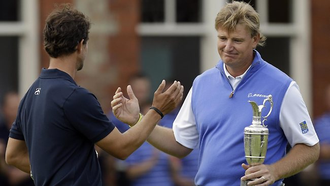KNOW how you feel: Ernie Els commiserates with Adam Scott after winning the British Open following Scott's implosion.