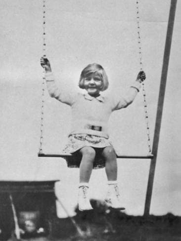 Actress Lauren Bacall pictured as a young child playing on a swing, USA, circa 1930. Picture: Getty