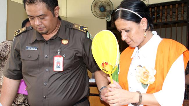 Taken in handcuffs ... Leeza Ormsby escorted by the prosecutor for her trial in Denpasar District Court in Bali.