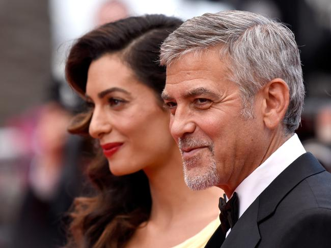 Amal and George Clooney pose on the red carpet in May, 2016. Picture: Clemens Biran