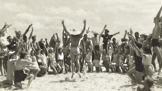 Gold Coast 'Schoolies' in the 1950s. Revelers perform the 'Hokey Pokey' on Greenmount Beach.